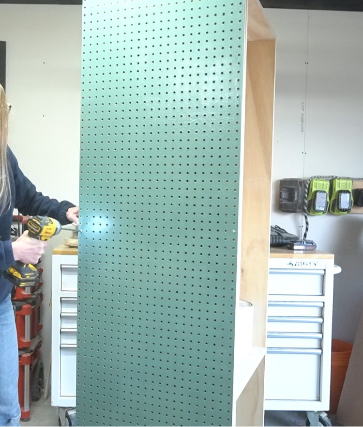 Install peg board panel onto side of cabinet onto spacer blocks