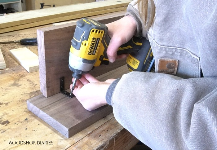Securing corner brackets on front and top flip top pieces to attach together