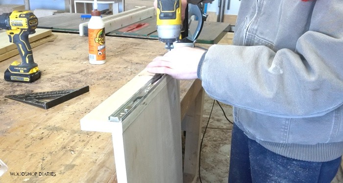 Installing drawer slides onto desk pull out tray