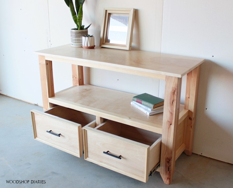 Shelf staged for photos with drawers open to show storage inside