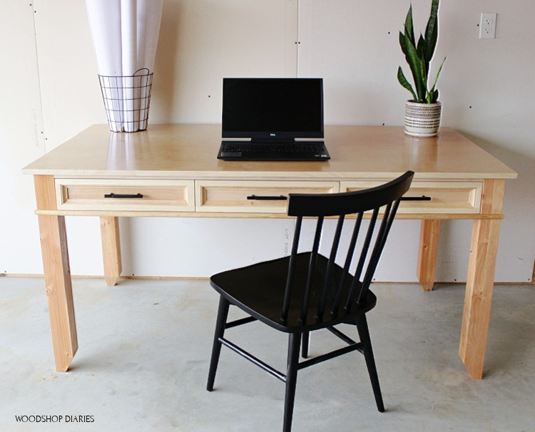 Front view of simple writing desk made from plywood and 2x4s