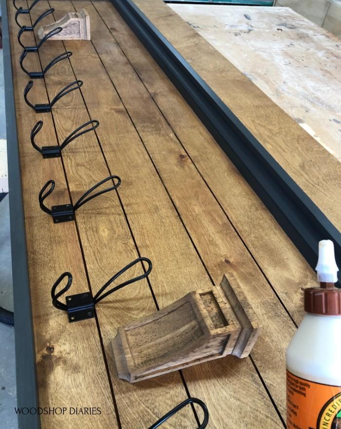 Corbels glued onto front of coat rack back panel