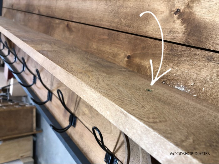 Image showing screws used to attach shelf to corbels on coat rack