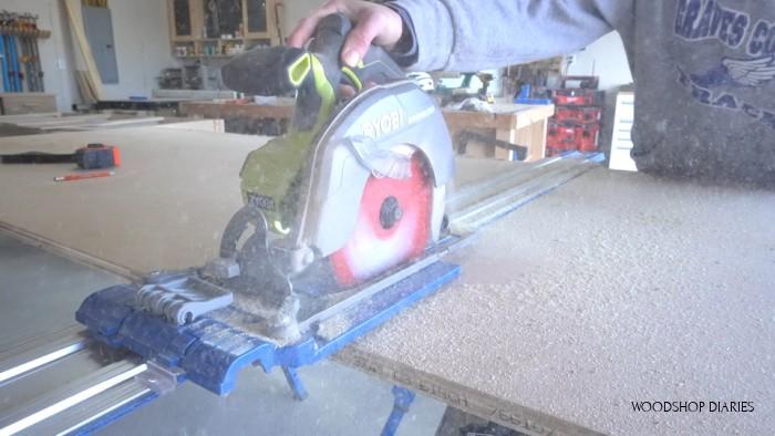 Using a circular saw to cut down plywood sheet