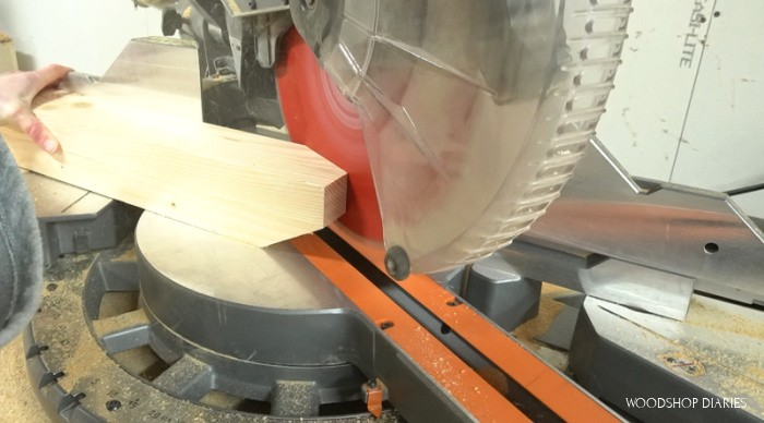 Miter saw set to 60 degrees cutting taper on end of desk leg