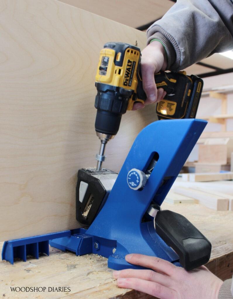 Kreg 720 pocket hole jig on workbench drilling holes into plywood panel