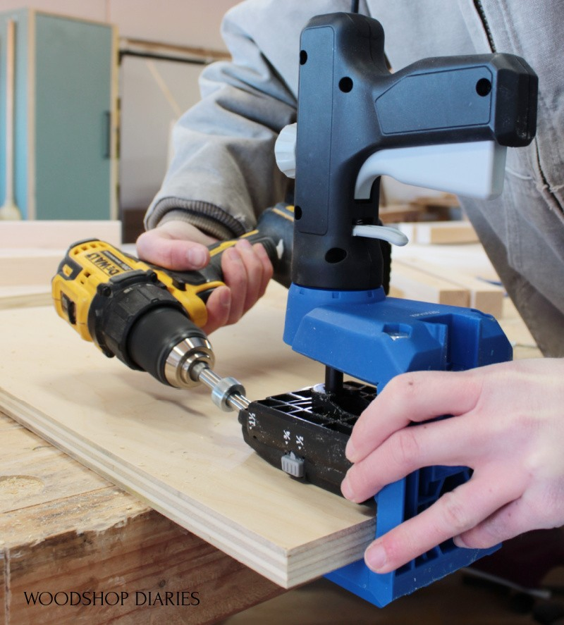 Shara Woodshop Diaries drilling pocket hole into plywood panel using the Kreg 520 jig