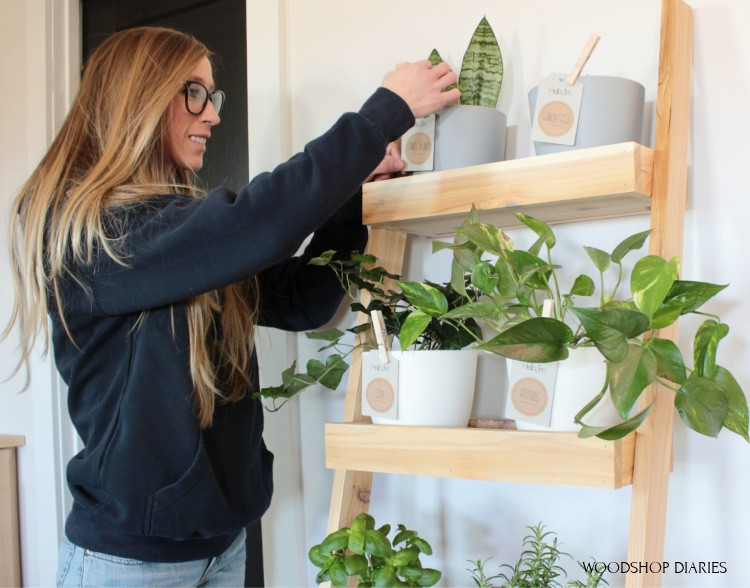 Shara Woodshop Diaries clipping name tags onto planter pots