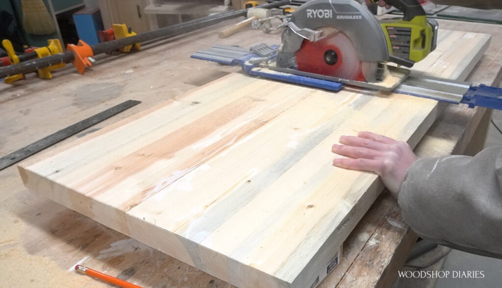 Shara using circular saw and AccuCut to trim shelf panel from slab