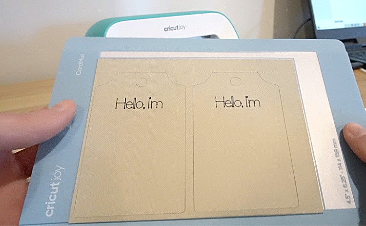 Close up of Cricut Joy cardstock plant name tags cut out on card mat