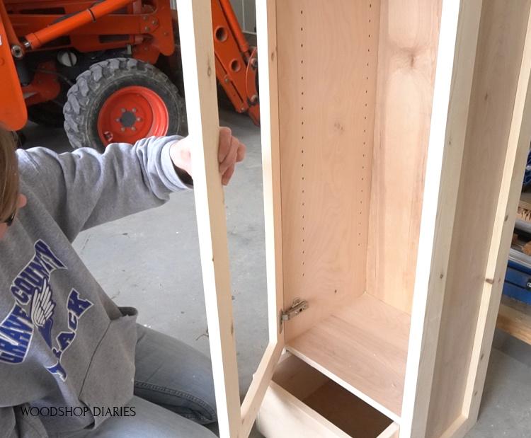 Installing door into pantry cabinet