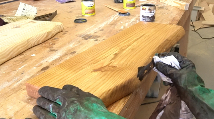 Applying dark Kona stain to DIY faux live edges to highlight fake bark