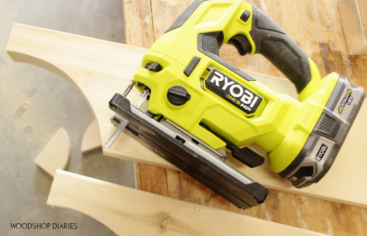 Close up of Ryobi HP jig saw used to cut curves on 2x6 boards for cart handle