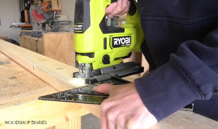 Using a jig saw and a square to cut pieces for grill cart frame