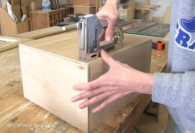 "using staple gun to install ¼"" plywood drawer bottom into drawer box"