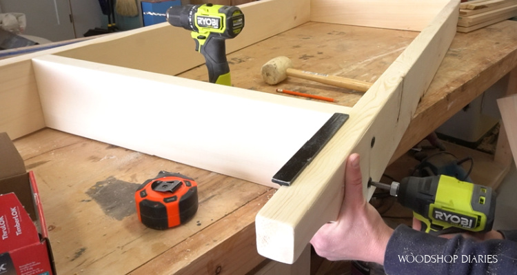 Using a speed square to keep pieces in place while driving screws