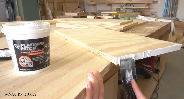 Shara using DAP Platinum patch to cover and seal plywood edges