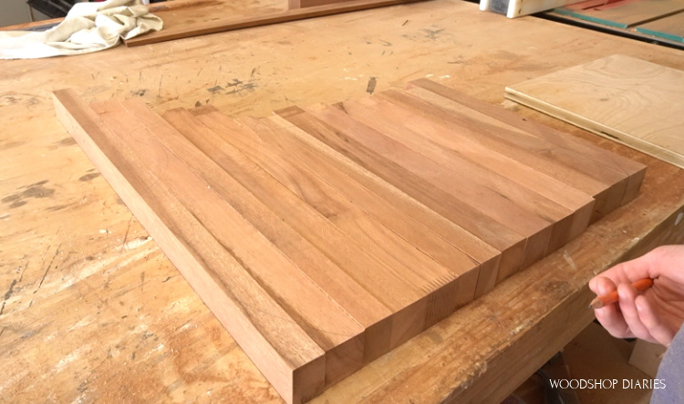 Door pieces laid out on workbench longest to shortest to determine best size of cutting board