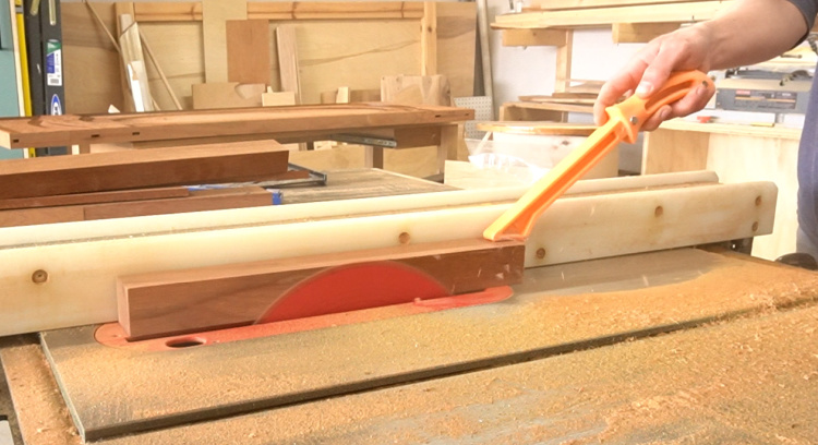 Running pieces through table saw to remove veneer layer
