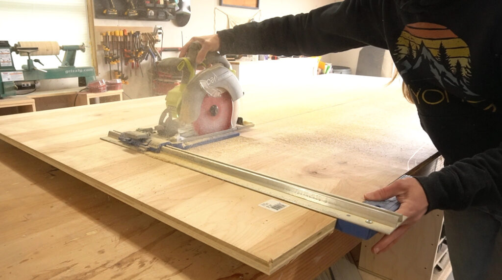 Shara Woodshop Diaries cutting down plywood sheet with circular saw