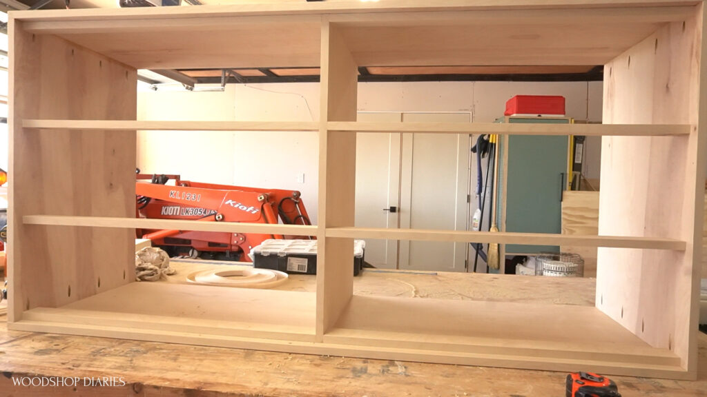 Dresser body assembled with dividers sitting on workbench ready for slides