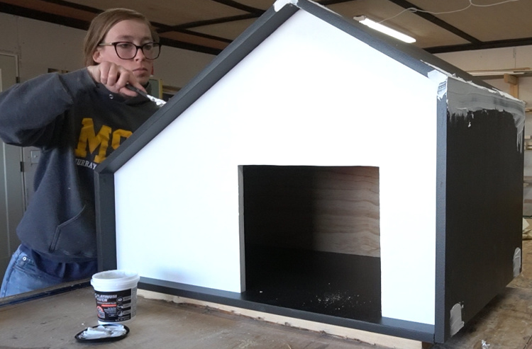 Shara Woodshop Diaries using DAP Platinum Patch filler to seal seams and screw heads on DIY outdoor dog house