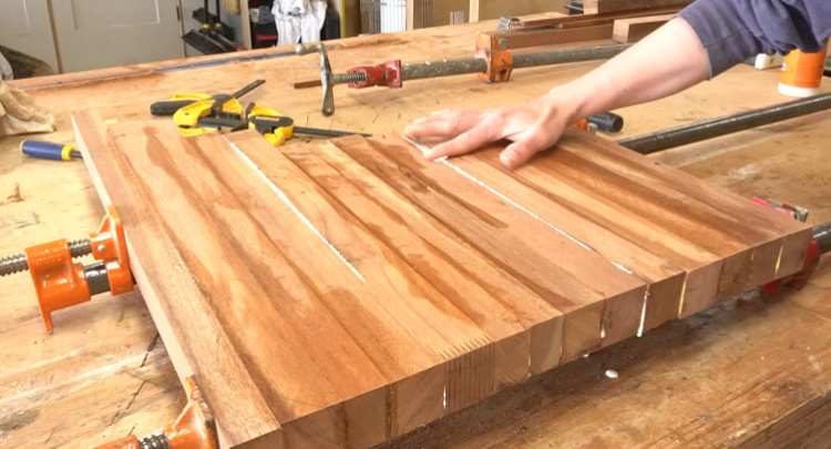 Gluing up multiple sections of cutting board in pipe clamps