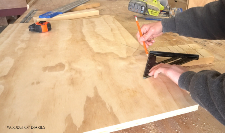 Using a speed square to mark 60 degrees for roof peak of DIY pet house front panel