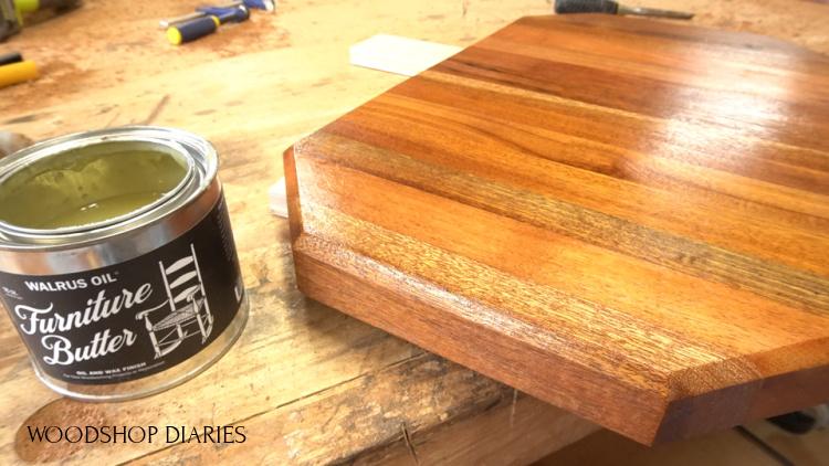Applying Walrus Oil Furniture Butter to cutting board