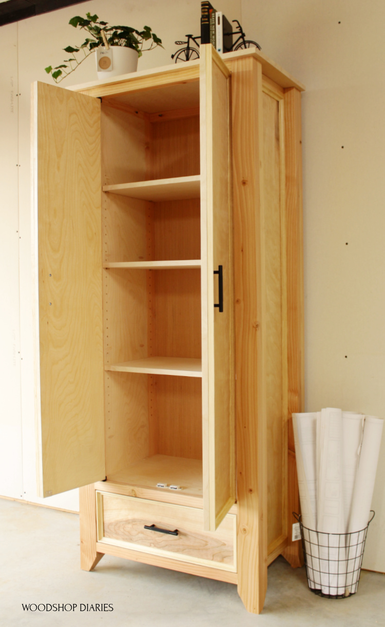 Finished and completed DIY armoire wardrobe cabinet with doors open and shelves installed