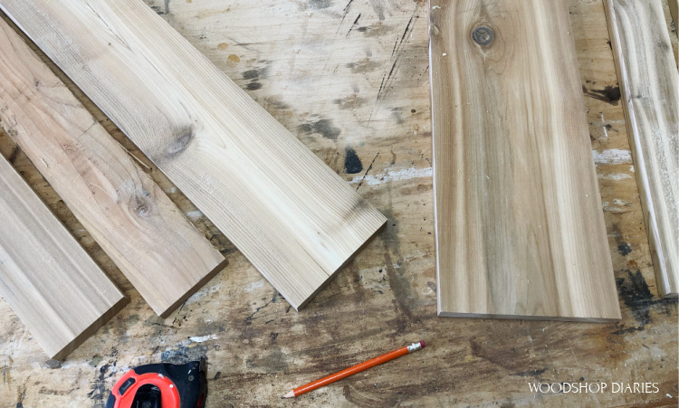 Scrap cedar laid out on workbench