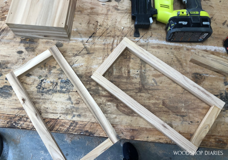 Two rectangle frames assembled on workbench to make lantern top from