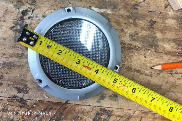 Measuring tape measuring the diameter of solar light