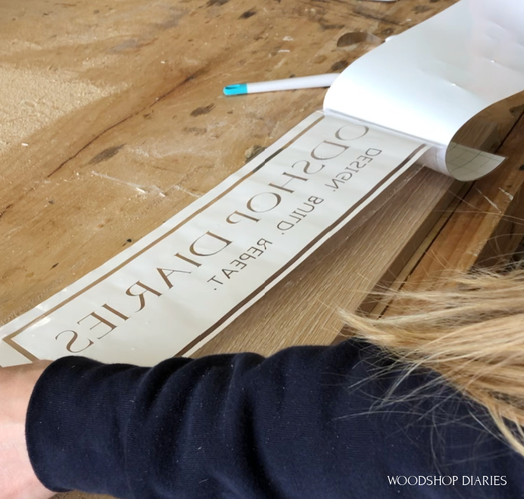 Removing back from vinyl stencil to add lettering to DIY wooden sign