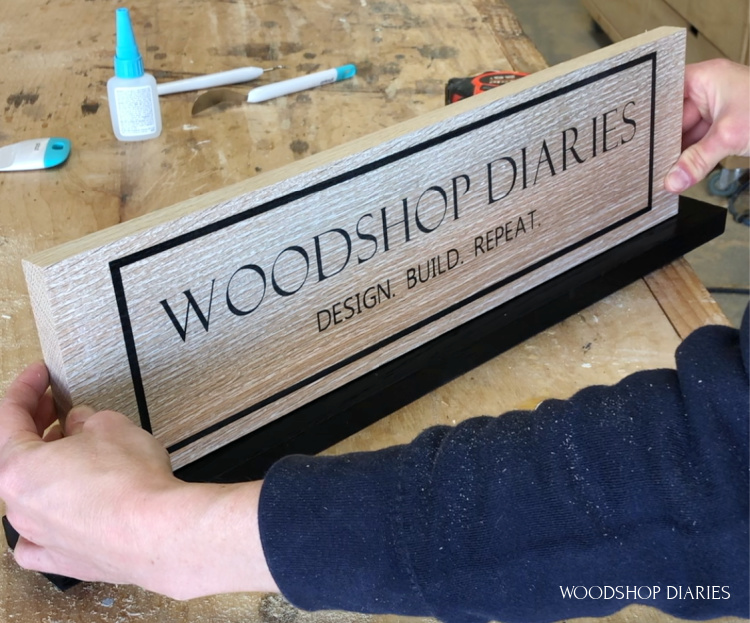 Gluing vertical custom wooden sign onto base plate to stand on its own