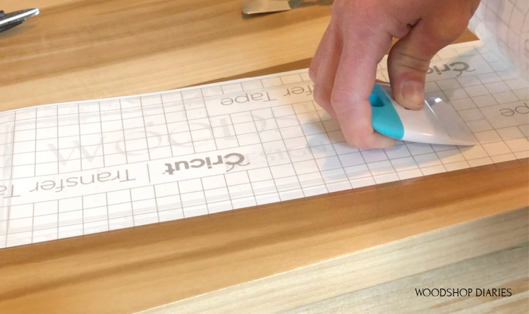 Applying transfer tape to vinyl stencil