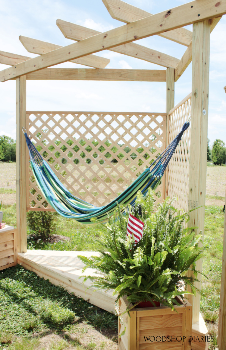 Vertical view of DIY hammock stand with floating corner deck and corner top pergola