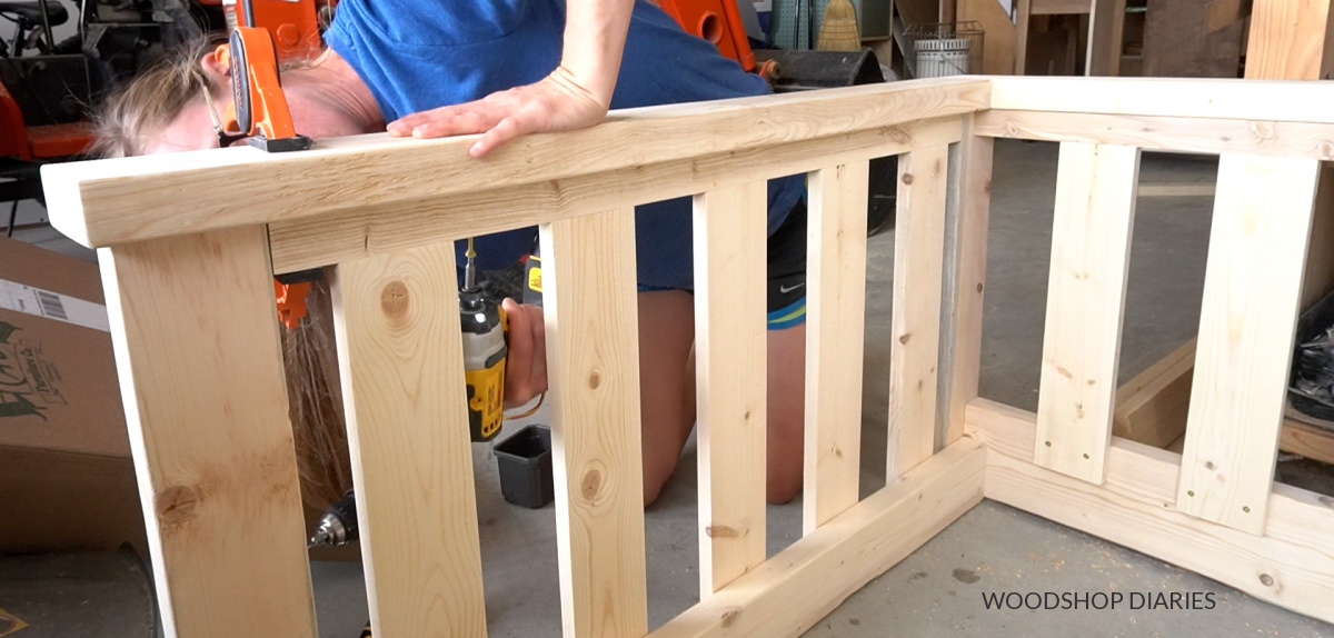 Close up of installing arm rests on swing frame through underside of 2x2s