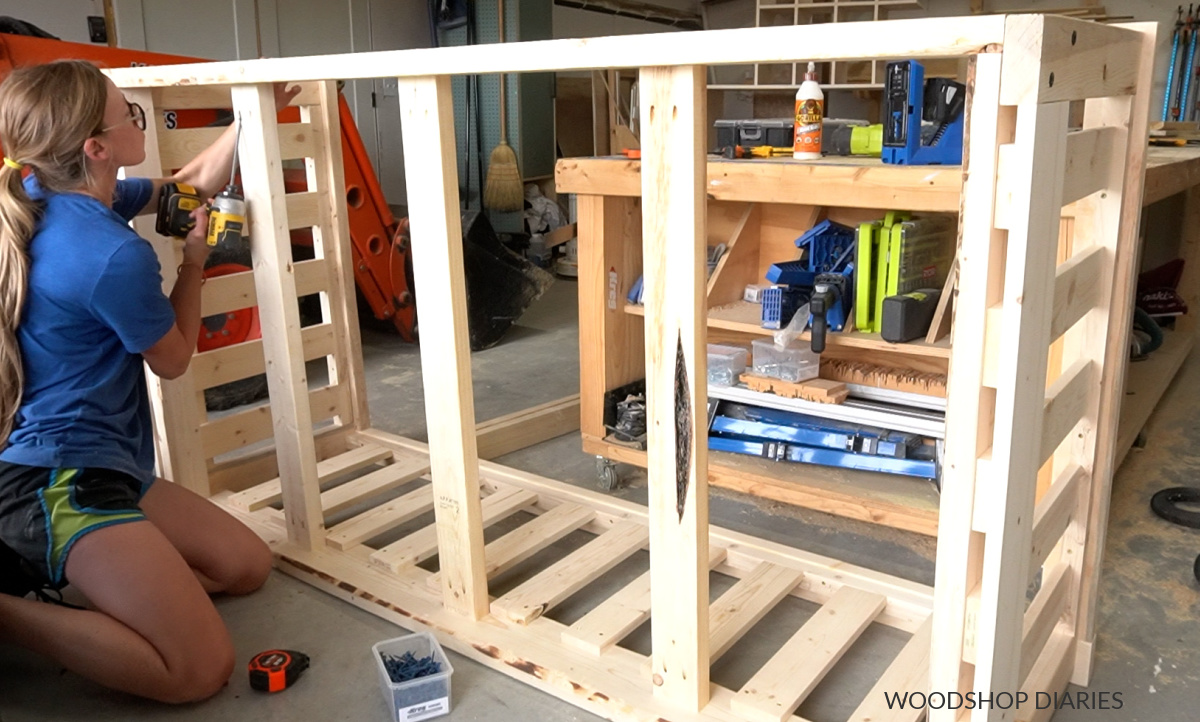 Shara Woodshop Diaries screwing mattress supports in place in bottom side of swing frame using pocket holes and screws