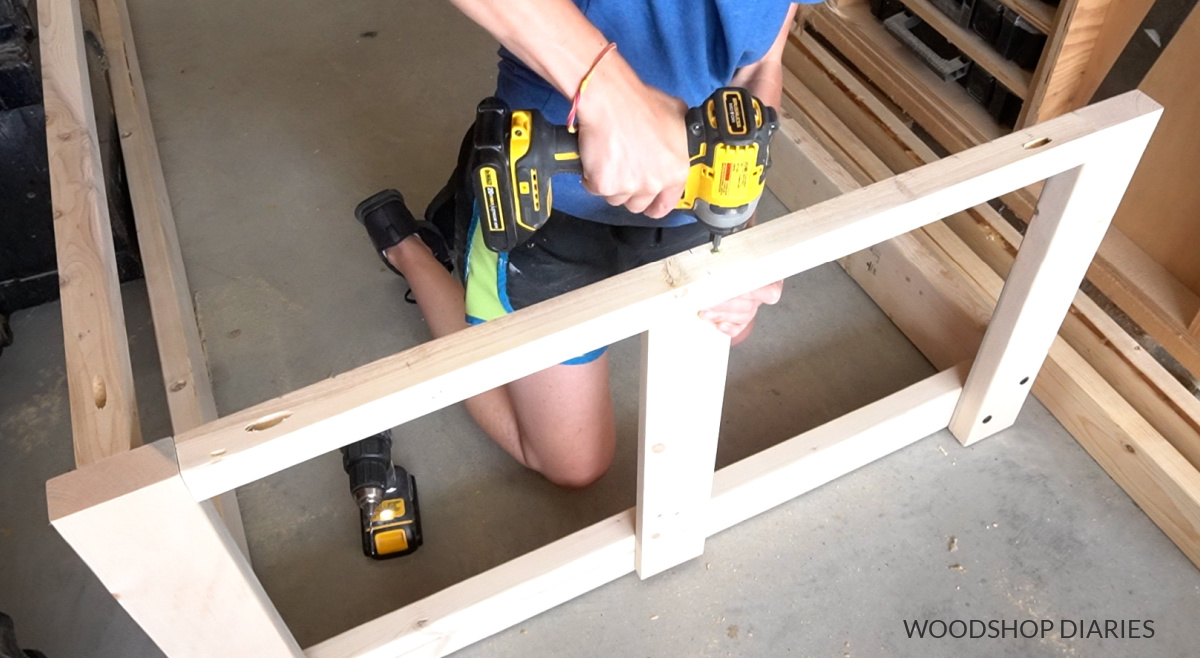 Shara Woodshop Diaries screwing slats in place on side of swing bed frame