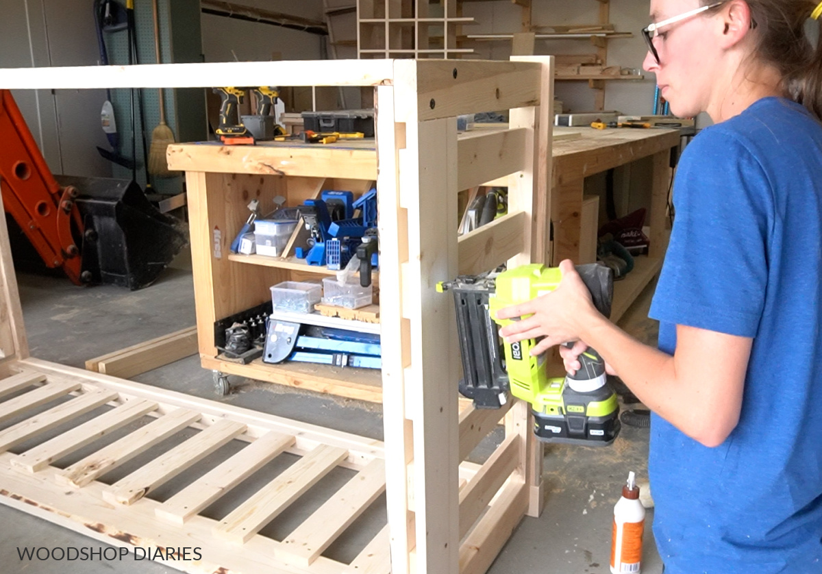 Shara Woodshop Diaries using a nail gun to install trim piece on side of swing frame