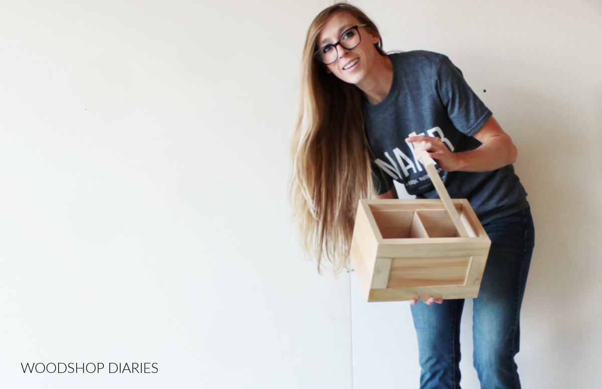 Shara Woodshop Diaries holding simple keepsake box with lid lifted off