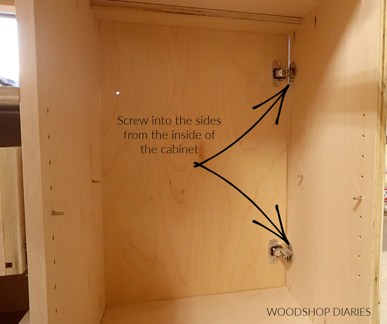 Inside cabinet view of hinges installed onto dresser