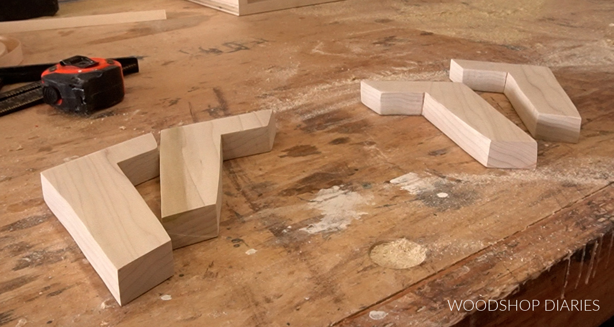four mid century legs cut out and laid on workbench