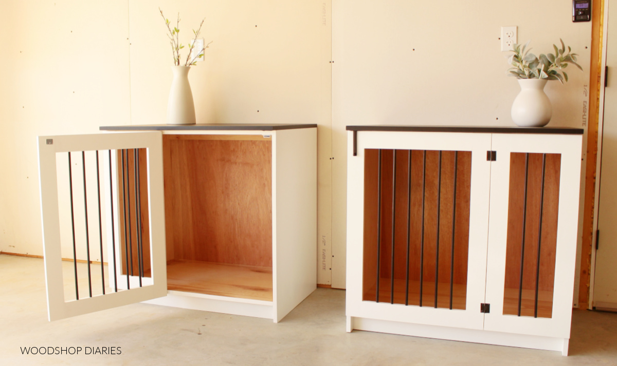Black and White DIY wooden dog crates sitting side by side with one door open