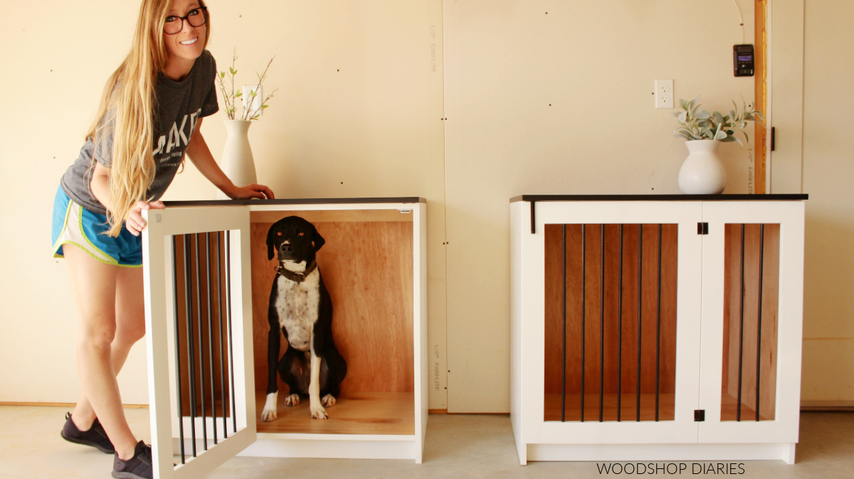Shara Woodshop Diaries with dog, Lucy, showing finished black and white dog crate with door open