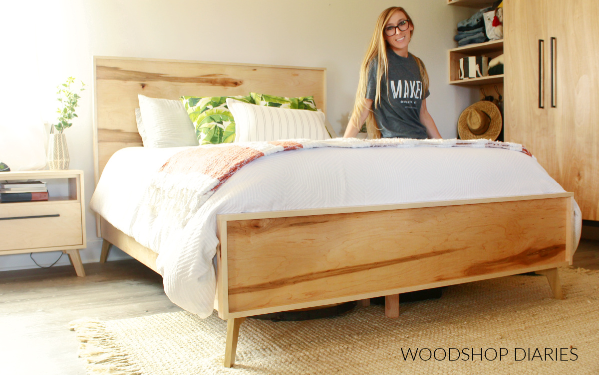 Shara Woodshop Diaries sitting on modern bed assembled in bedroom with matching modern nightstands