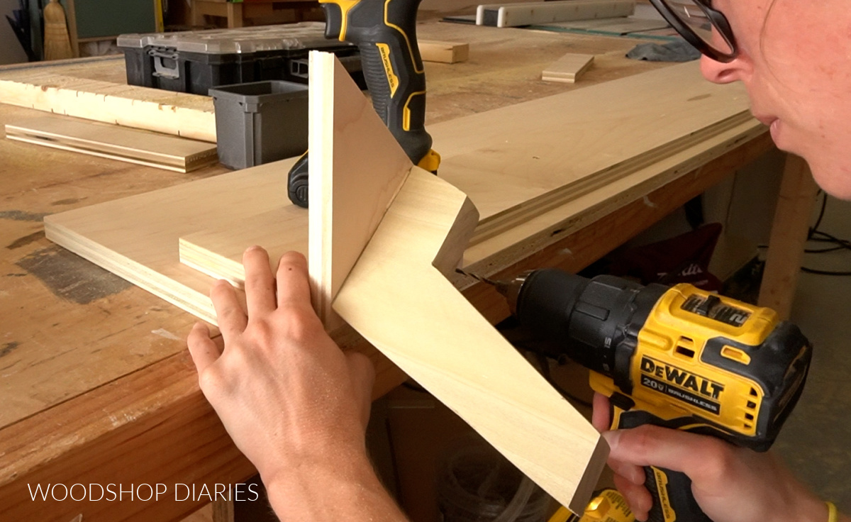 Screwing foot plates to footboard of mid century modern bed