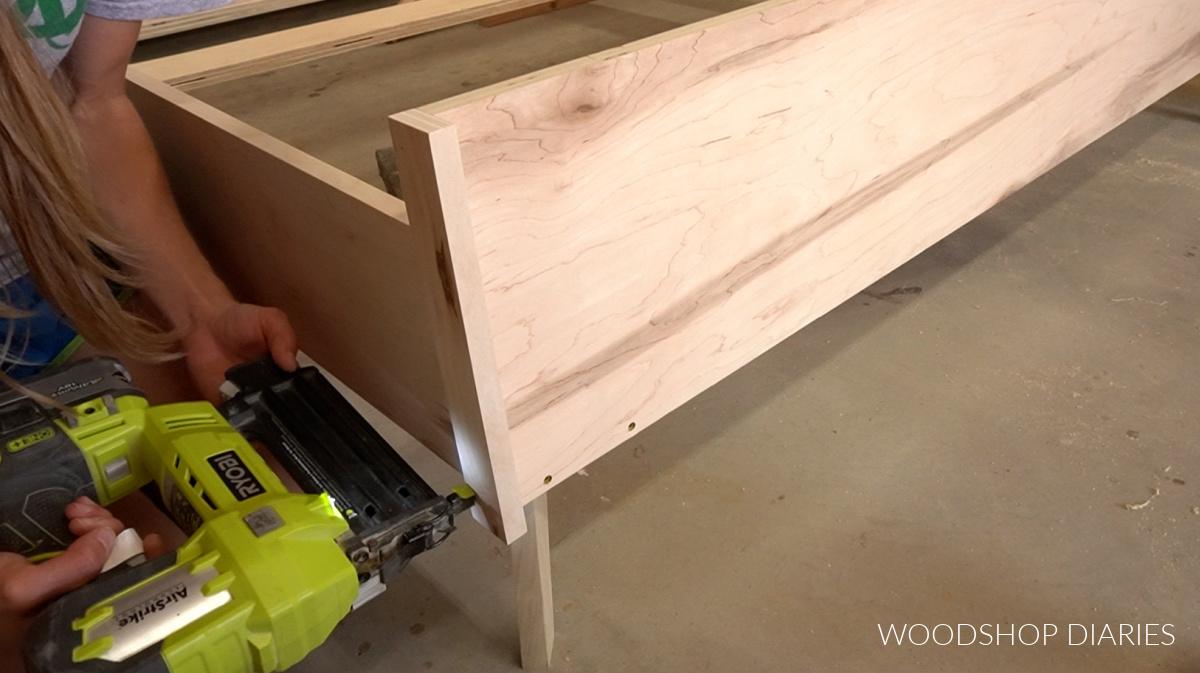 Glue and brad nail trim pieces around footboard