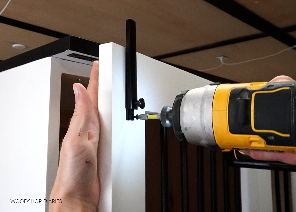 Close up of installing surface bolt latch onto dog crate door